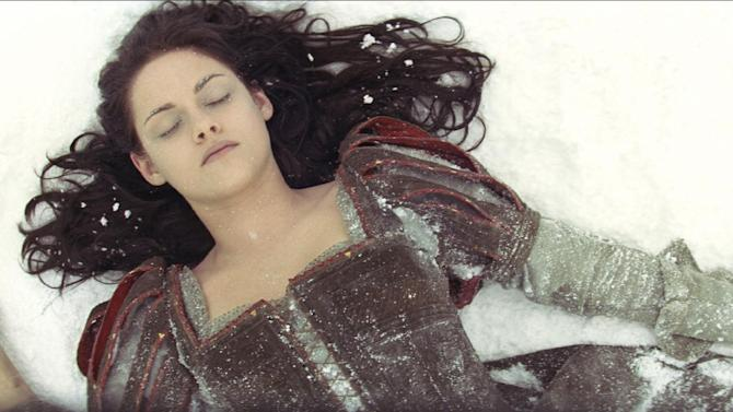 """This film image released by Universal Pictures shows actress Kristen Stewart in a scene from """"Snow White and the Huntsman."""" (AP Photo/Universal Pictures)"""