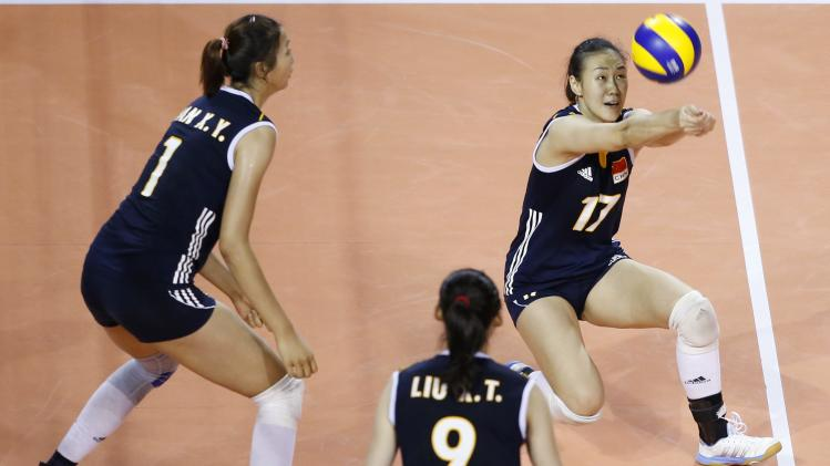 Wang of China receives the ball during their FIVB Women's Volleyball World Grand Prix 2014 final round match against Turkey in Tokyo
