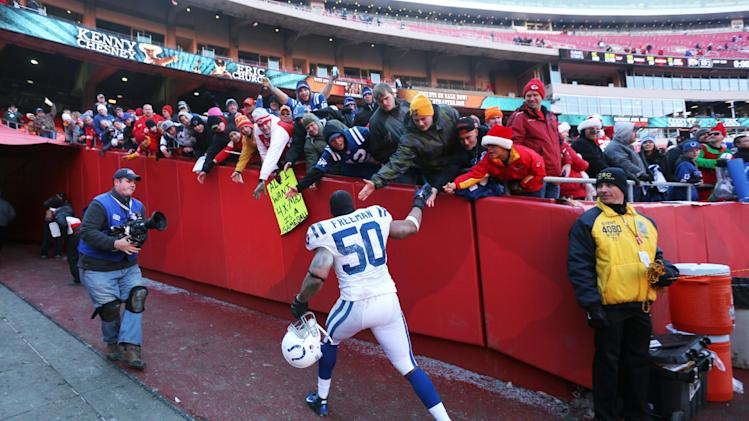Indianapolis Colts inside linebacker Jerrell Freeman (50) celebrates with fans after an NFL football game against the Kansas City Chiefs on Sunday, Dec. 23, 2012, in Kansas City, Mo. The Colts won 20-13.  (AP Photo/Ed Zurga)