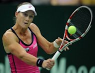 Australia&#39;s Samantha Stosur returns a ball to France&#39;s player Alize Cornet during the Kremlin Cup tennis tournament in Moscow. Stosur won 7-6 (8/6), 7-5 in two hours 28 minutes