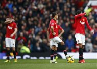 (L to R) Manchester United's Phil Jones, Javier Hernandez and Robin van Persie react during their English Premier League soccer match against Newcastle United at Old Trafford in Manchester, northern England December 7, 2013. REUTERS/Darren Staples