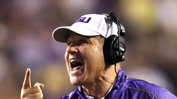LSU head coach Les Miles calls out to in the second half of their NCAA college football game against Mississippi in Baton Rouge, La., Saturday, Nov. 17, 2012. LSU won 41-35. (AP Photo/Gerald Herbert)