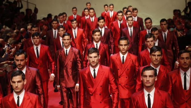 Models wear creations for Dolce & Gabbana men's Spring-Summer 2015 collection, part of the Milan Fashion Week, unveiled in Milan, Italy, Saturday, June 21, 2014. (AP Photo/Luca Bruno)