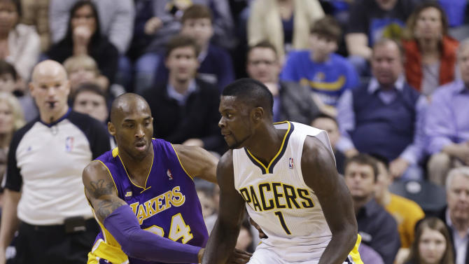 Los Angeles Lakers guard Kobe Bryant, left, defends Indiana Pacers guard Lance Stephenson during the first half of an NBA basketball game in Indianapolis, Friday, March 15, 2013.  (AP Photo/Michael Conroy)
