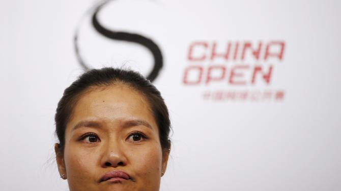 Li Na of China reacts during a news conference announcing her retirement in Beijing