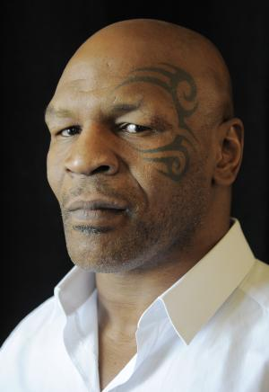 "FILE - In this July 25, 2013, file photo, boxer MIke Tyson poses backstage during HBO's Summer 2013 TCA panel at the Beverly Hilton Hotel in Beverly Hills, Calif. At one time he was the baddest man on the planet, a heavyweight champion who terrorized anyone who got in his way, inside the ring or out. More recently he's unburdened himself as perhaps the most tortured soul on earth, with a one-man show on Broadway that Spike Lee has turned into an HBO special airing Nov. 16. Now he's got a new autobiography that might be the most soul baring book of its genre ever written. The title is ""Undisputed Truth,"" and the truth is that Mike Tyson is one messed up dude. (AP Photo/ Chris Pizzello, Invision)"