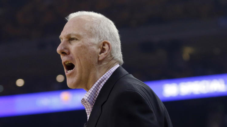San Antonio Spurs head coach Gregg Popovich argues a call during the first half of Game 3 of a Western Conference semifinal NBA basketball playoff series against the Golden State Warriors in Oakland, Calif., Friday, May 10, 2013. (AP Photo/Marcio Jose Sanchez)