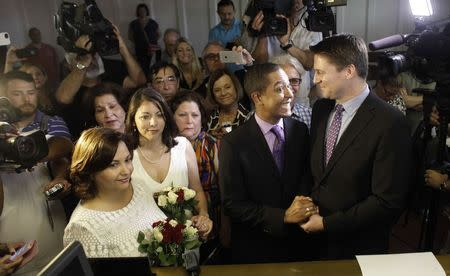 Same-sex couples Todd and Jeff Delmay with Catherina Pareto and Karla Arguello get married at the Eleventh Judicial Circuit Court of Florida in Miami ...