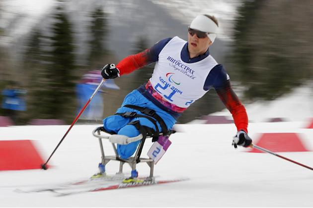 Roman Petushkov of Russia races to win the men's 15-kilometer cross country ski sitting event at the 2014 Winter Paralympics, Sunday, March 9, 2014, in Krasnaya Polyana, Russia