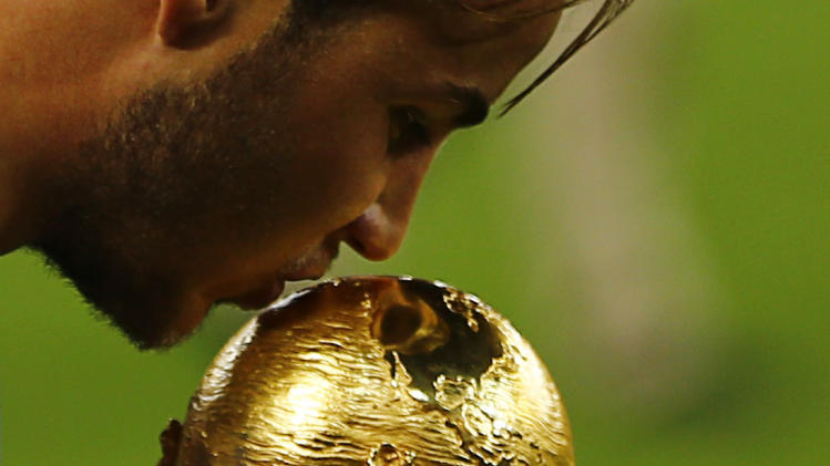 Germany's Mario Goetze kisses the World Cup trophy as he celebrates their 2014 World Cup final win against Argentina at the Maracana stadium in Rio de Janeiro