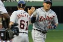 Detroit Tigers&#039; Miguel Cabrera (24) slaps the hand of third base coach Tom Brookens (61) on the way to the plate, after hitting a three-run homer during the third inning of a baseball game against the Texas Rangers, Sunday, May 19, 2013, in Arlington, Texas. (AP Photo/John F. Rhodes)