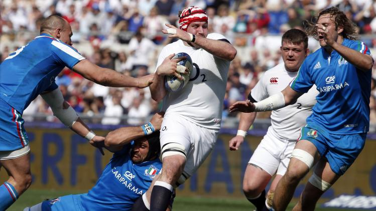 England'sMorgan is tackled by Italy's Furno and Parisse during Six Nations rugby union match at Olympic Stadium in Rome