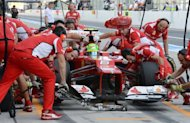 Mechanics change tyres of the machine of Ferrari driver Felipe Massa of Brazil during the first free practice session in the Formula One Japanese Grand Prix in the Suzuka circuit on October 5. Fernando Alonso was fifth for Ferrari and Massa ninth