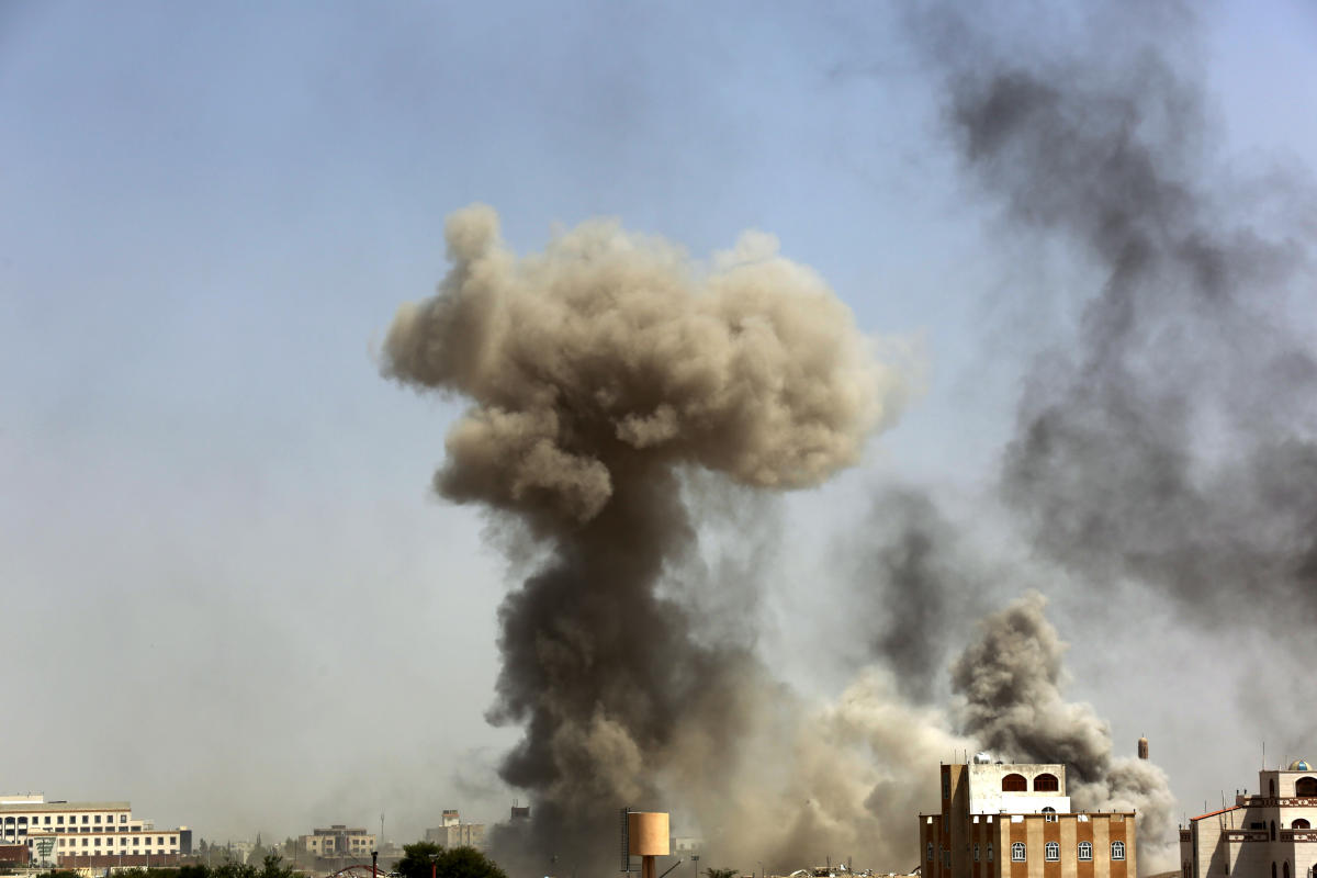 Smoke rises after a Saudi-led airstrike hits an army academy in Sanaa, Yemen, Sunday, Sept. 20, 2015. In the western province of Ibb, the Saudi-led coalition's airstrikes against a Shiite rebel stronghold and prison facility have killed more than 10 and wounded more than 50 rebels and civilians, security officials and witnesses said. (AP Photo/Hani Mohammed)