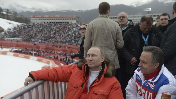 Russian President Vladimir Putin and Sports Minister Vitaly Mutko watch a skiing event at the Paralympic Winter Games at Rosa Khutor near Sochi