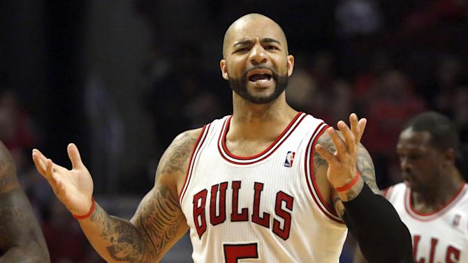 Chicago Bulls power forward Carlos Boozer complains to a referee about a call against him during the first half of Game 3 of their first-round NBA basketball playoff series against the Brooklyn Nets, Thursday, April 25, 2013, in Chicago. (AP Photo/Charles Rex Arbogast)
