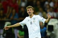 Bayern Munich midfielder Thomas Mueller, pictured in June 2012, admits he is wary of his team&#39;s opening match of the Bundesliga season, as they prepare to travel to top-flight debutants Greuther Fuerth on Saturday