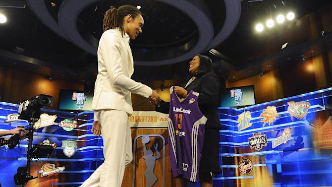 Brittney Griner, left, shakes hands with WNBA President Laurel J. Richie after the Phoenix Mercury selected Griner as the No. 1 pick in the WNBA basketball draft, Monday, April 15, 2013, in Bristol, Conn. (AP Photo/Jessica Hill)