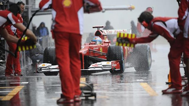 Ferrari's Spanish driver Fernando Alonso arrives in the pits during the second practice session at the Spa-Francorchamps circuit (AFP)