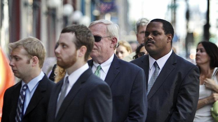 Philadelphia Commissioner of the Department of Licenses and Inspections Carlton Williams, second from right, waits in line to attend a memorial service at the Pennsylvania Academy of the Fine Arts in Philadelphia on Sunday June 9, 2013. The service was for Anne Bryan, who was among the victims of the fatal building collapse in Philadelphia on Tuesday.  (AP Photo/Joseph Kaczmarek)