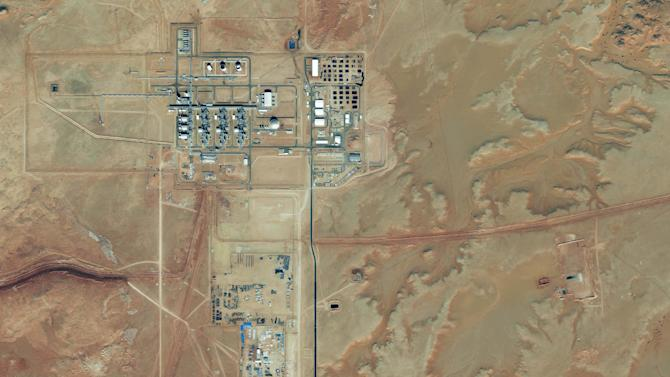 This Nov. 29, 2012 satellite image provided by DigitalGlobe shows the Amenas Gas Field in Algeria, which is jointly operated by BP and Norway's Statoil and Algeria's Sonatrach. Algerian special forces launched a rescue operation Thursday Jan. 17, 2013 at the plant in the Sahara Desert and freed foreign hostages held by al-Qaida-linked militants. The bloody three-day hostage standoff took a dramatic turn Friday as Algeria's state news service reported that nearly 100 of the 132 foreign workers kidnapped by Islamic militants had been freed. That number of hostages at the remote desert facility was significantly higher than any previous report, but it still left questions about the fate of over 30 other foreign energy workers. (AP Photo/DigitalGlobe)