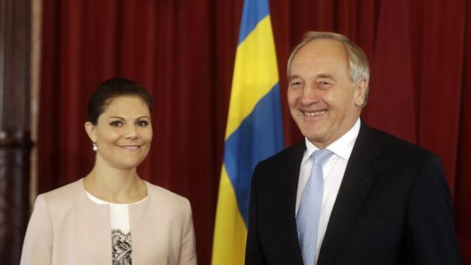 Sweden's Crown Princess Victoria and Latvia's President Berzins pose for media during their meeting in Riga
