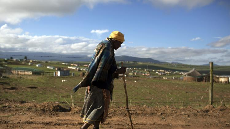 A woman walks in a rural village near Mthatha in the Eastern Cape
