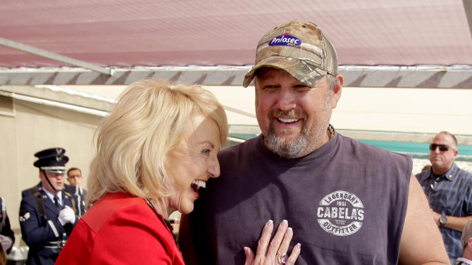 Frequent heartburn sufferer and comedian, Larry the Cable Guy & Arizona governor Jane Brewer at the Phoenix International Raceway before the race to promote new Prilosec OTC Wildberry and encourage fans to enter the Wild American Flavor Sweepstakes at www.WildberryFlavor.com on Sunday, Nov. 11, 2012, in Avondale, Ariz.(AP Photo/Rick Scuteri)