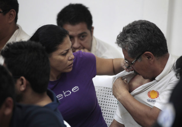 Mexican national Raquel Alatorre Correa, left, looks at the shoulder of a fellow detainee, both facing organized crime and money laundering charges, during a court hearing to face additional indictmen