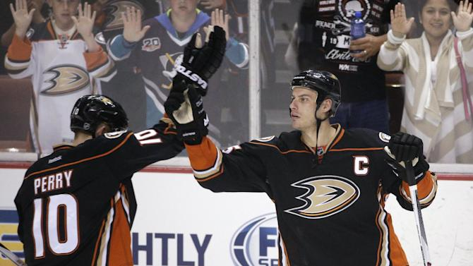 Anaheim Ducks' Corey Perry, left, and Ryan Getzlaf celebrate the team's 5-1 win over the Edmonton Oilers in an NHL hockey game Wednesday, April 1, 2015, in Anaheim, Calif. (AP Photo/Jae C. Hong)