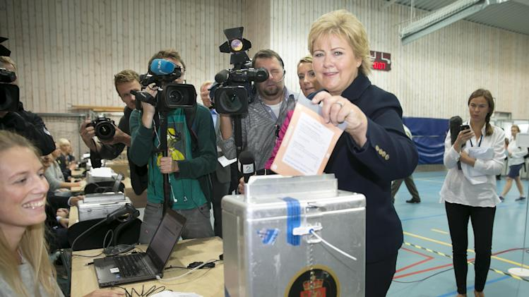 Chairman of the Conservative Party in Norway, Erna Solberg, casts her vote in the general election Monday Sept. 9, 2013 at the polling station at Apeltun School in Bergen, western Norway. The Conservative party is expected to do well, and Solberg may well, according to opinion polls, be in a position to form a a new coalition government after the elections. (AP Photo/Heiko Junge / NTB scanpix) NORWAY OUT