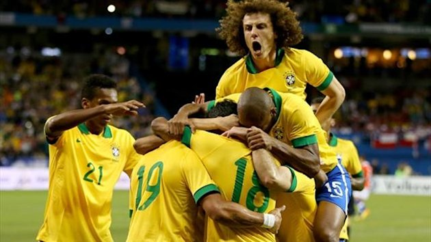 Brazil players celebrate their first goal against Chile in a friendly in Toronto (AFP)