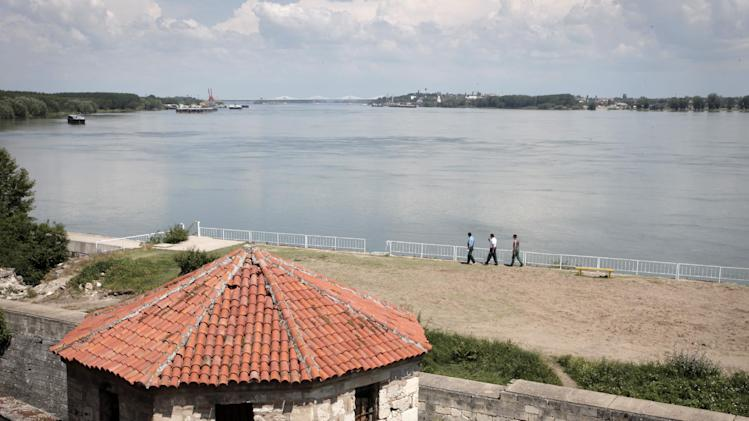 "This photo taken on Thursday, June 13, 2013 shows a view of the Danube River from the town of Vidin, Bulgaria with the new bridge between Bulgaria and Romania in the distance. The bridge is the second on the 500-kilometer stretch of the Danube River that forms the common border between the Balkan neighbors, and is touted as a key to boosting growth in one of Europe's poorest regions. But skeptics argue that dilapidated infrastructure on both sides of the river will turn it into ""a bridge to nowhere."" (AP Photo/Valentina Petrova)"