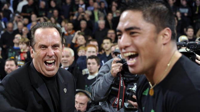 Notre Dame coach Mike Brey, left, celebrates with Notre Dame football player Manti Teo following the team's 64-50 victory over Kentucky in an NCAA college basketball game Thursday, Nov. 29, 2012, in South Bend, Ind. (AP Photo/Joe Raymond)