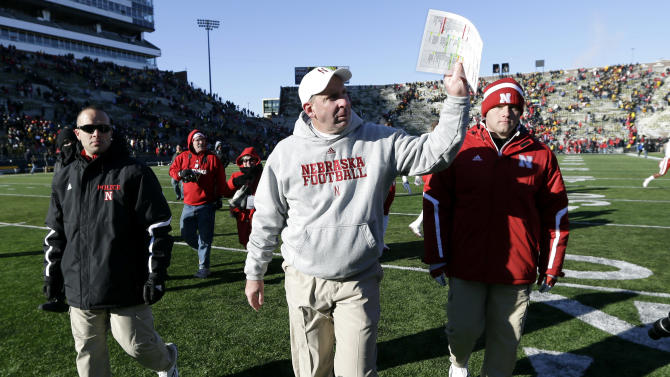 Nebraska head coach Bo Pelini waves to fans as he walks off the field after their 13-7 victory over Iowa in an NCAA college football game, Friday, Nov. 23, 2012, in Iowa City, Iowa. (AP Photo/Charlie Neibergall)