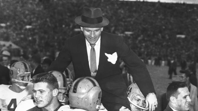 FILE - In this Nov. 16, 1957, file photo, Notre Dame head coach Terry Brennan is carried off Owen Field by Jim Just (44) and other players following their 7-0 win over Oklahoma in an NCAA college football game in Norman, Okla. Notre Dame's Ron Toth (43) and Jim Colosimo (41) also celebrate the final. That victory ended the Sooners' NCAA-record winning streak at 47 games and came just a season after the Sooners beat the Irish 40-0 in South Bend, still the most lopsided home loss in Notre Dame history. (AP Photo/File)