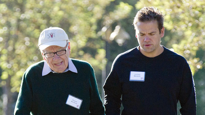 FILE - In this July 9, 2011 file photo, Rupert Murdoch, left, walks with his son Lachlan Murdoch to the morning sessions during the last day of the 2011 Allen and Co. Sun Valley Conference, in Sun Valley, Idaho (AP Photo/Julie Jacobson, file)