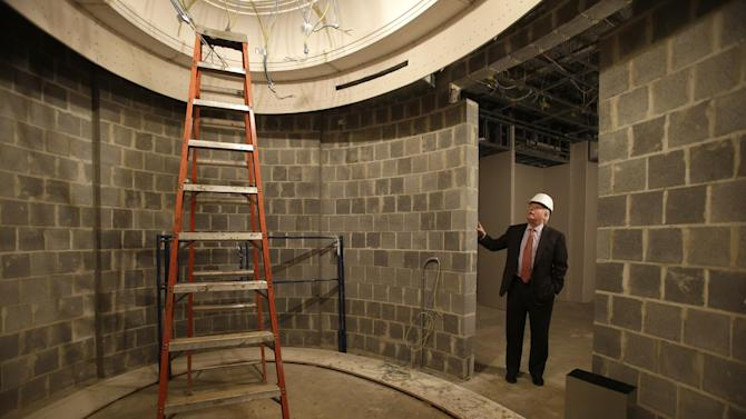 In this Wednesday Feb. 13, 2013 photo, Curt Viebranz, the president of George Washington's historic Mount Vernon estate, stands outside what will be a climate controlled book vault inside the under-construction George Washington Library, at Mount Vernon, Va. (AP Photo/Jacquelyn Martin)