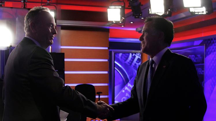 """Republican presidential candidate Mitt Romney, right, shakes hands with Bill O'Reilly after his interview for his Fox News program """"The O'Reilly Factor,"""" in New York,  Monday, Dec. 19, 2011. (AP Photo/Richard Drew)"""