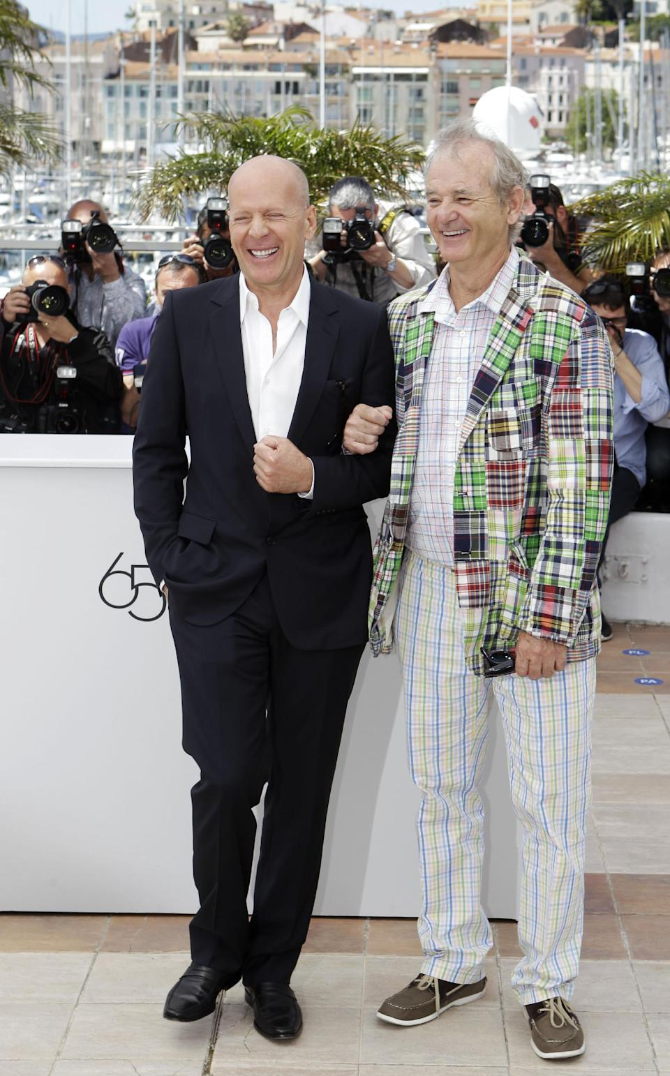 Actors Bruce Willis, left and Bill Murray pose during a photo call for Moonrise Kingdom at the 65th international film festival, in Cannes, southern France, Wednesday, May 16, 2012. (AP Photo/Lionel Cironneau)