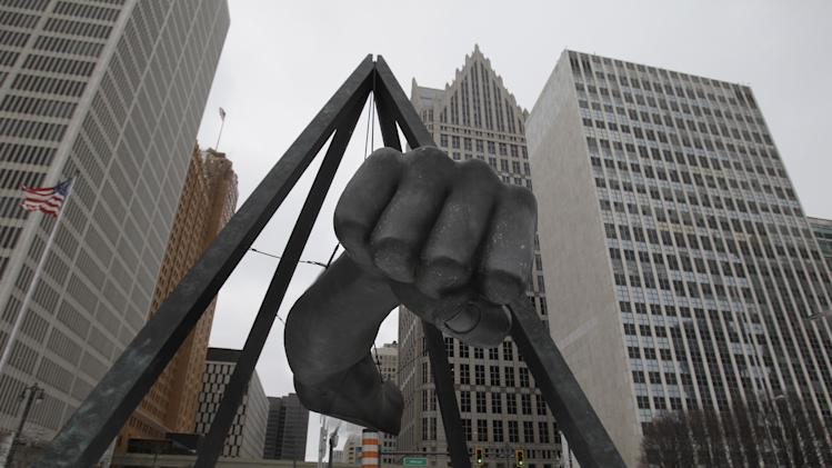 FILE - In this Feb. 7, 2011 file photo is the Monument to Joe Louis in Detroit.  A state-appointed review team Tuesday, Feb. 19, 2013 determined Detroit is in a financial emergency, paving the way for Republican Gov. Rick Snyder to appoint an emergency manager who would need to come up with a new plan to get the city out of its fiscal crisis.   (AP Photo/Carlos Osorio, File)