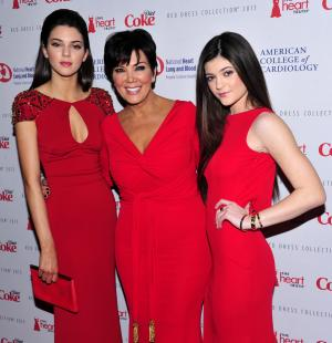 From left, Kendall Jenner, Kris Jenner and Kylie Jenner attend the Red Dress Collection 2013 Fashion Show, on Wednesday, Feb. 6, 2013 in New York. (Photo by Charles Sykes/Invision/AP)
