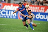 Grenoble&#39;s fullback Joaquim Tuculet (L) is tackled by Mont-de-Marsan&#39;s Yohann Durquet during their French Top 14 rugby union match at the Lesdiguieres stadium in Grenoble. Grenoble won 52-7
