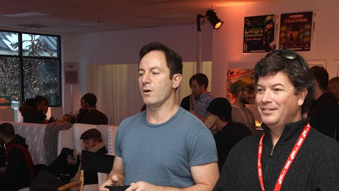 Jason Isaacs, left, and Jason Netter warm up and check out Wii U at the Nintendo Lounge during a break from the Sundance Film Festival on Saturday, January 20, 2013 in Park City, UT. (Photo by Donald Traill/Invision for Nintendo/AP Images)