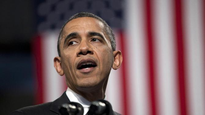 President Barack Obama pauses during his speech at Hyde Park Academy on Friday, Feb. 15, 2013, in Chicago.  Obama is traveling to promote the economic and educational plan he laid out in his State of the Union address.  (AP Photo/Evan Vucci)