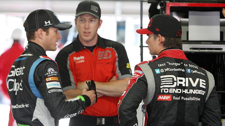 Driver Kasey Kahne, left, talks with Jeff Gordon after practice for Sunday's Sprint Cup Series at New Hampshire Motor Speedway, Saturday, July 12, 2014 in Loudon, N.H. (AP Photo/Jim Cole)