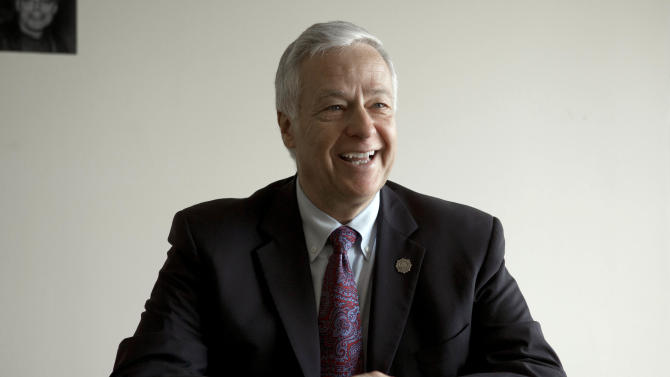 In this photo made Friday, Nov. 8, 2013, Rep. Mike Michaud speaks to a reporter in Portland, Maine. Michaud said coming out as gay has been a positive experience, with congratulations pouring in from his GOP counterpart on the Veterans Affairs Committee and one of the six other openly gay members of the House. (AP Photo/Robert F. Bukaty)