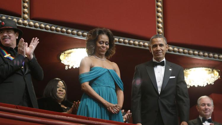 U.S. President Barack Obama and first lady Michelle Obama arrive in their box for the Kennedy Center Honors in Washington