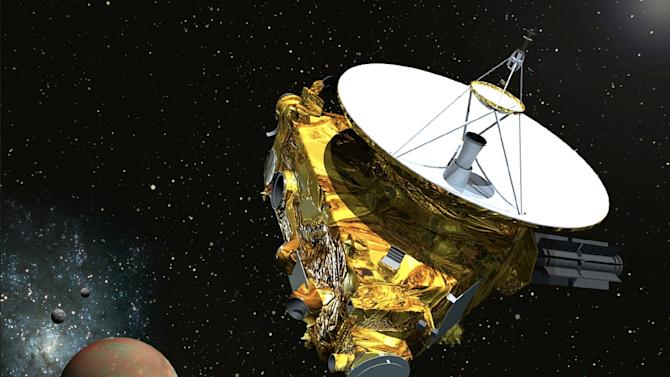 Artist's image obtained December 1, 2014, courtesy of NASA/Johns Hopkins University Applied Physics Laboratory/Southwest Research Institute, shows the New Horizons spacecraft as it approaches Pluto and its three moons in summer 2015