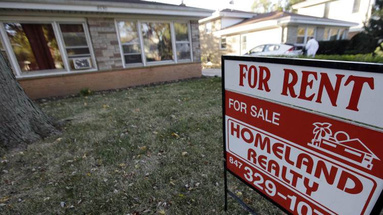 This Wednesday, Oct. 10, 2012, photo, shows a home for-sale in Skokie, Ill. The average U.S. rate on a 30-year fixed mortgage fell this week to near its record low set earlier this month. (AP Photo/Nam Y. Huh)